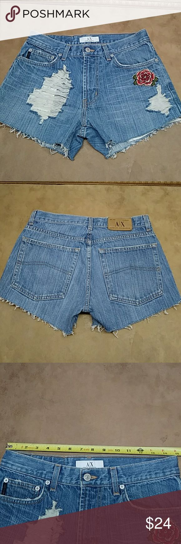 """Armani Exchange distressed jean shorts 30 Cute distressed jean shorts with adorable flower patch. Here are the measurements lying flat: Waist:15"""" Rise:9.5"""" Inseam:3"""" Outer Seam:10.5"""" Armani Exchange Shorts Jean Shorts"""