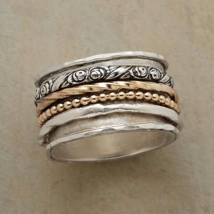 I'd leave the bottom solid band and just have the stacking rings all in silver