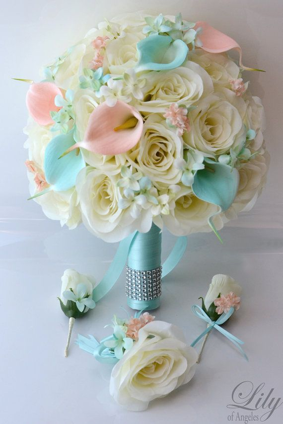 Model: BLPI04 This wedding flower package is made with white open Roses, Robins Egg Blue and peach Calla Lilies accented with Robins Egg Blue Rock