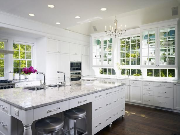 Open yet Traditional Kitchen.  Island w/ lots of drawers. (a little sleek for me but I like the big island!)