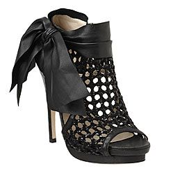 Val - Nine West: Peep toe bootie with woven leather.