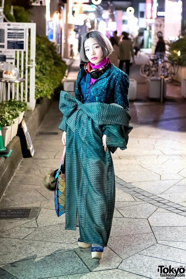Vintage Green Kimono Worn as Coat. We met Uno – with a pastel bob hairstyle – on the famous Cat Street in Harajuku.  Her look features a vintage green kimono (which she bought at a flea market) worn as a coat over a dress from Pony Stone, layered jackets, fishnets, and platform heels from 2% Tokyo. Her geometric handbag is from the BaoBao collection by Japanese designer Issey Miyake.  Uno's favorite fashion is by NiceSence and she likes the Japanese musicians Utada Hikaru and Sia.