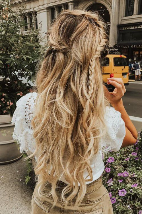 Blonde with a messy braid.