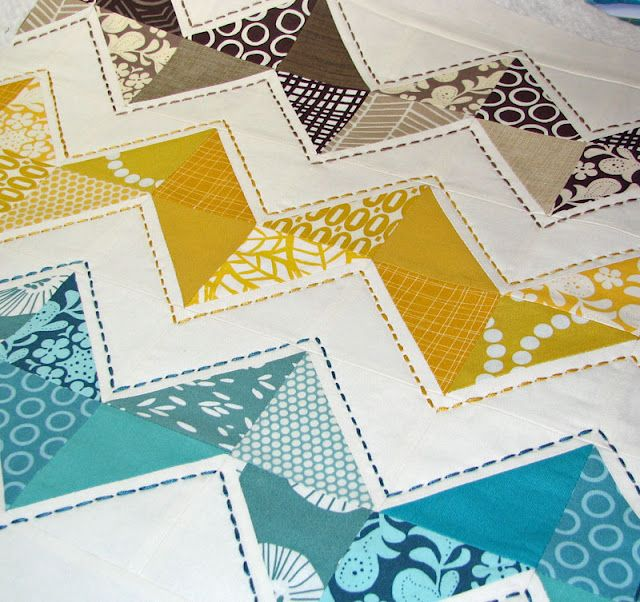 the contrast stitching! Great way to make a simple / easy quilt very special.