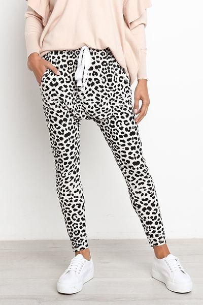 98c467397cc13 Casual meets funky and wild in these slim fit leopard print harem pants  with drawstring waist band.