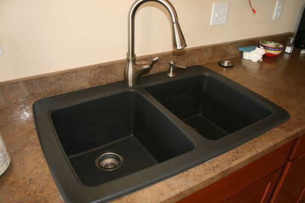How to clean your black granite composite sink- first using the vinegar and baking soda and then using the Dawn- followed by cooking oil or some kind of oil. - gets rid of white stains.