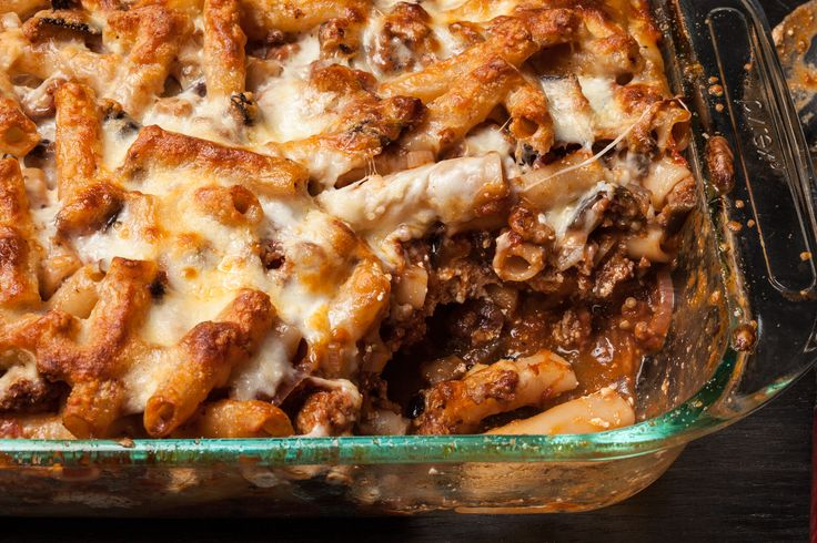 A classic baked ziti recipe, with Italian sausage, eggplant, ricotta, mozzarella, and Parmesan cheeses.