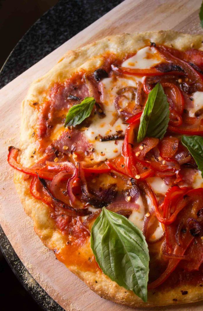 Best Ever Homemade Pizza- an incredible pie that the whole family will love with sauce, easy pizza dough and toppings that will rival your local pizza favorite! |wordslikehoneycomb.com