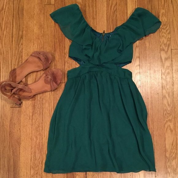 Green cocktail dress with cutouts Ruffled shouldered cocktail dress, with a back closing zipper and two side cutouts. Hits right above the knee Dresses