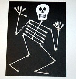 Black construction paper, draw a white face cut it out and glue on, add q-tips for body