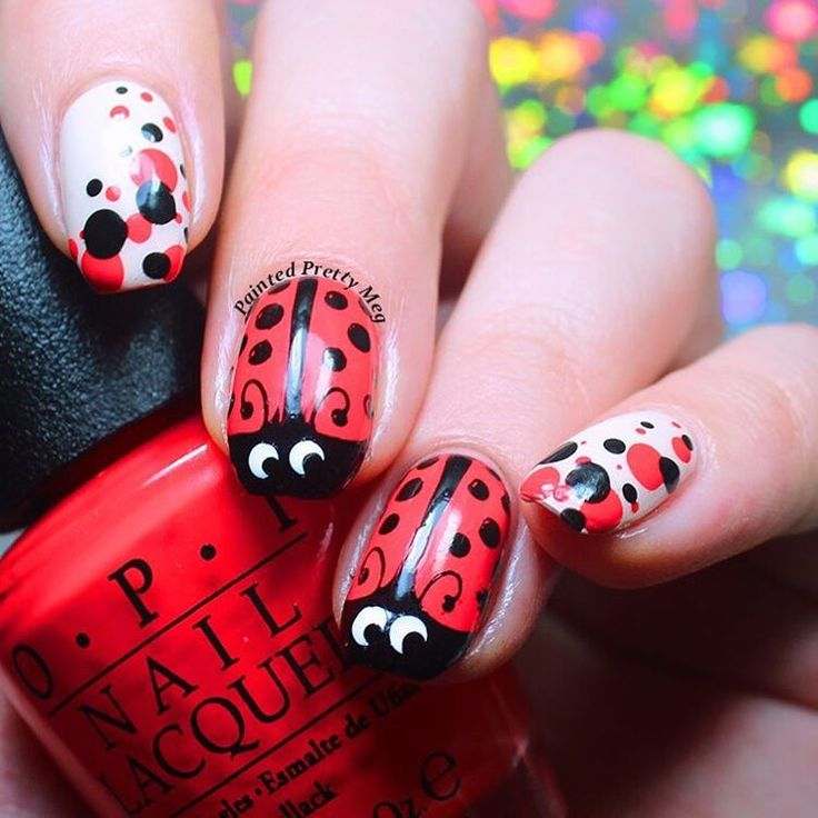 This lady bug-inspired manis is perfect for Spring! Check these awesome nails by @paintedprettymeg from Instagram. _______________________________________________ My day 11  ! For the #31dc2016 ! Today was polka dots so I did some  ! This is a recreation of a really old mani of mine that I have been wanting to redo forever, this seemed like the perfect time. These turned out even better than the first go at them! It really shows how much I have grown and improved since then!  any