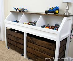 Organize the piles of toys in this toy storage console. Three open bins on top hold smaller toys and two large rolling bins hold larger toys. A rustic console that can easily grow with your child.