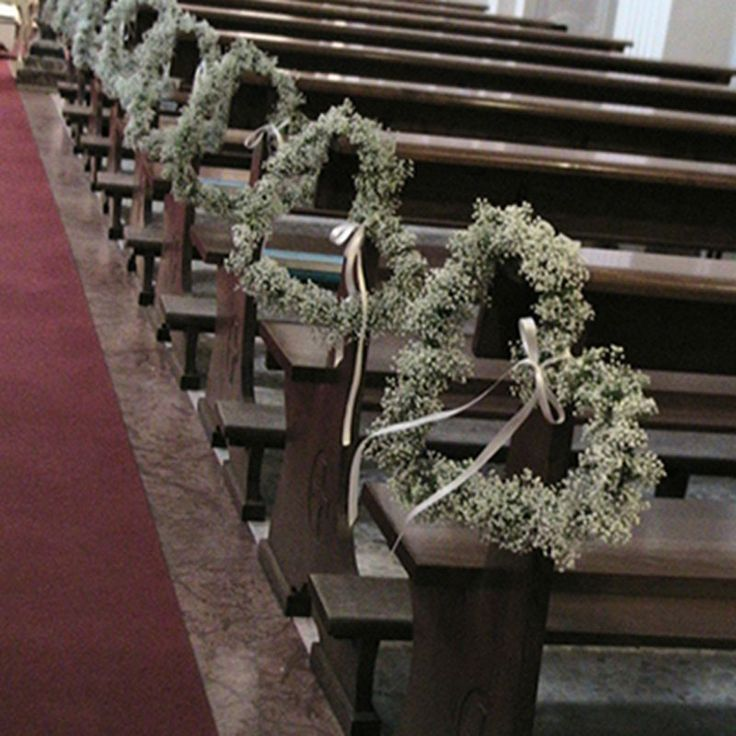 alfabridal.com   Absolutely Love these!!  Gypsophila Hearts! Make striking pew ends for the wedding ceremony.
