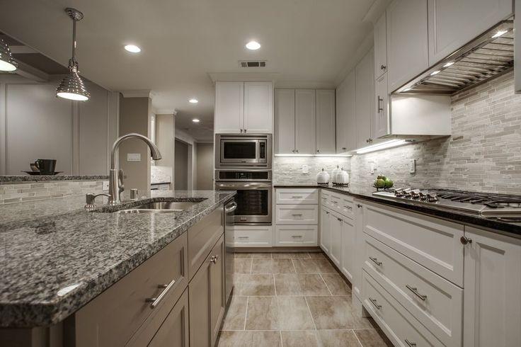 Contemporary Kitchen with Pendant Light, Complex granite counters, Galley, Caledonia Granite Countertop, Flush, Custom hood