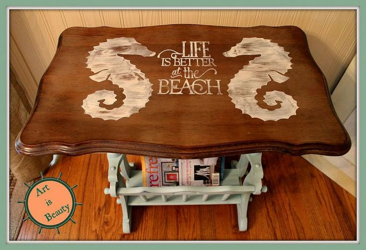 "Sea Horse ""beachy"" Magazine Rack End Table Makeover Come check out a cute little makeover I did on this old magazine rack end table. I painted the bottom and used my silhouette machine to cut out Sea horses from Karen - The Graphics Fairy and added the text ""life is better at the beach"". Using the vinyl stencil I hand painted on the graphic. When it was dry I lightly sanded and sprayed a protective coat of poly."