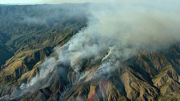 Highland brush fire closes Highway 330; structures threatened