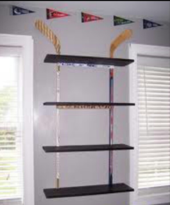 Hockey stick wall shelf