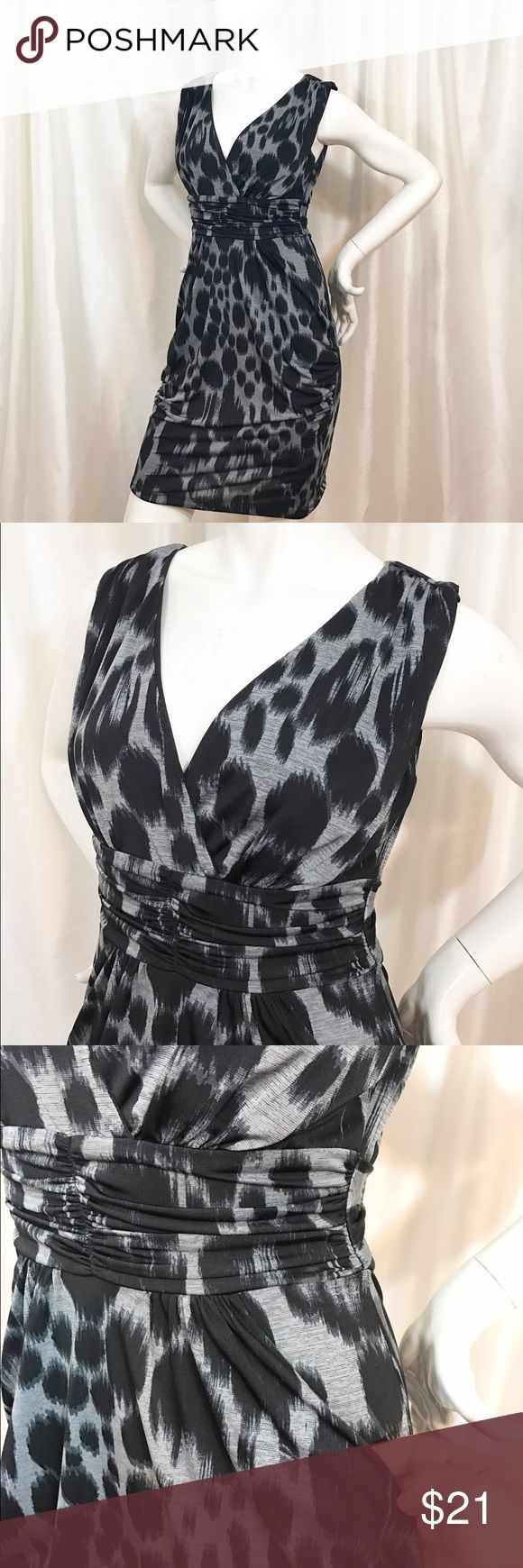 Black/Gray Animal Print Cocktail Dress sz M BCX Brand Dress from Macy's. Sleeveless V-neck cut strapped at the waist and ties in the back. With Pockets. Slinky and comfortable...very flattering. 94% Polyester 6% Spandex Sz M BCX Dresses