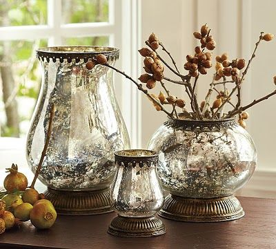 """Mercury glass vases - DIY TIP: To make your own mercury glass simply spritz glass with water then spray with Krylon """"Looking Glass"""" spray paint and voila!"""