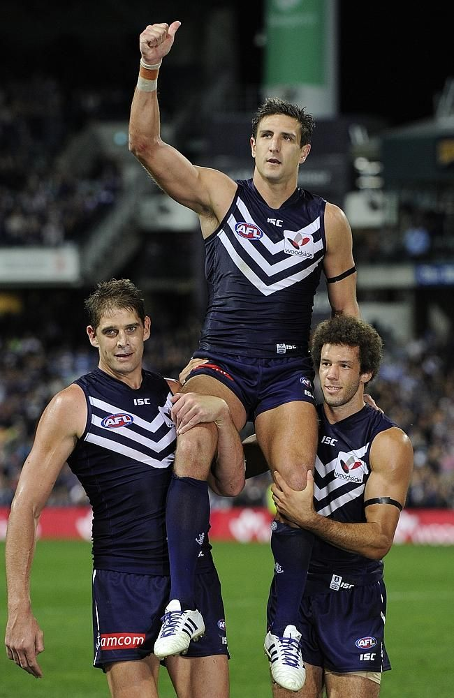 Matthew Pavlich is carried off the field by Aaron Sandilands and Zac Clarke. Picture: Dan
