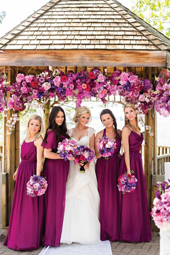 Loooove how bright these bridesmaid dresses and flowers are!