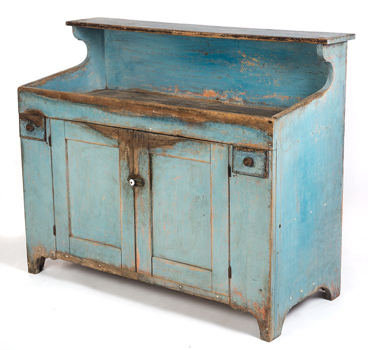 """Garths   Full Details for Lot 43 AMERICAN HOODED DRYSINK.  First half-19th century, poplar. Single small drawers flanking two large center doors. Cutout feet and sides, full-length open well and beaded doors. Surface has been cleaned down to the powder blue. Light wear around feet and some loss on the sides. 42""""h. 48.5""""w. 21.75""""d.  Estimate $ 700-900"""