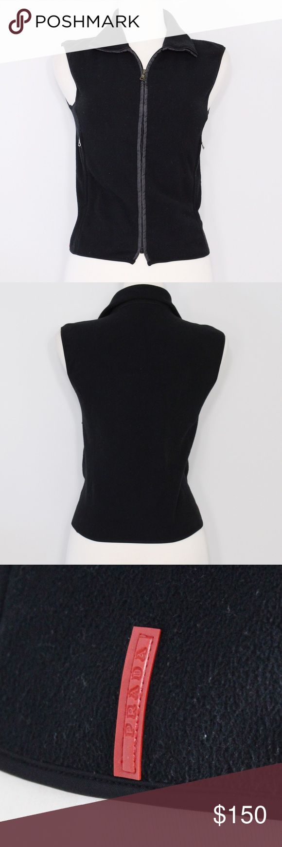 """PRADA Black Fleece Sport Vest Bust: 17"""" (laying flat, stretchy back)  Length: 20"""" (shoulder to hem)   A sleek, sporty vest in great condition! Zipper closure. Red """"PRADA"""" logo on left side. Functional zipper pockets. No holes or stains. Comes from a smoke free environment.  👌🏻Offers welcome through offer button 📦Bundles welcome ❌NO trades, please. ⚡️Same/Next day shipping Prada Jackets & Coats Vests"""