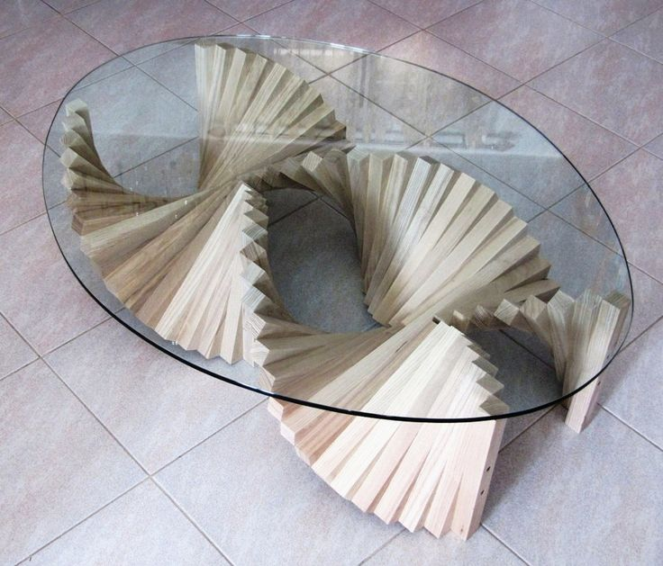 Simple repetition, makes beautiful objects. Twist coffee table in solid Ash, with crystal glass top.