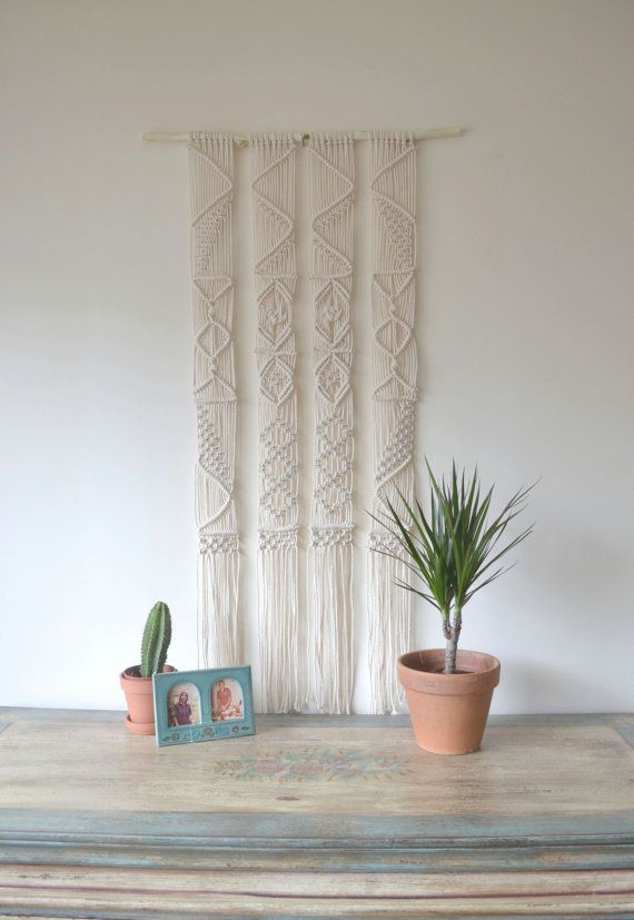 Bohemian macrame wall hanging with natural cotton twine on a reclaimed tree branch. 70s, minimal, ecological, modern, vintage, geometrical