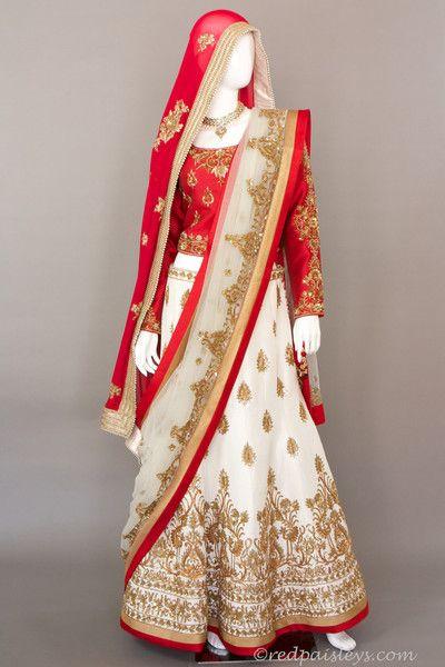Raw Silk lehenga and choli with antique gold zardosi work. Embellished with…