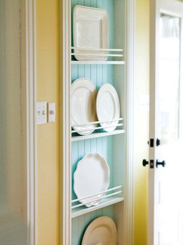 Old houses don't have much closet space.  I love the idea to make little shelves between the studs!  And, once again, the combo of turquoise and yellow feels so lighthearted.