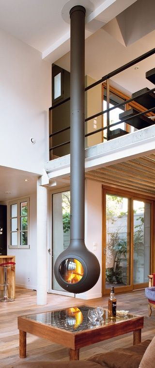 I'm not that crazy about this space overall, but there's something compelling about a submarine fireplace suspended from the ceiling.