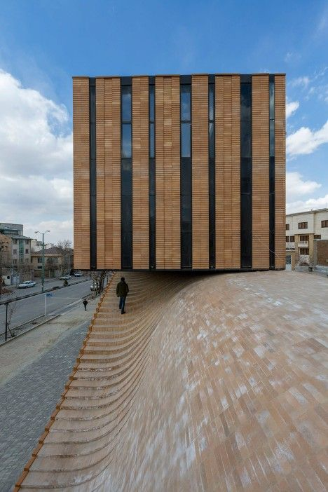 Undulating brick building in Iran encourages public to walk on its roof