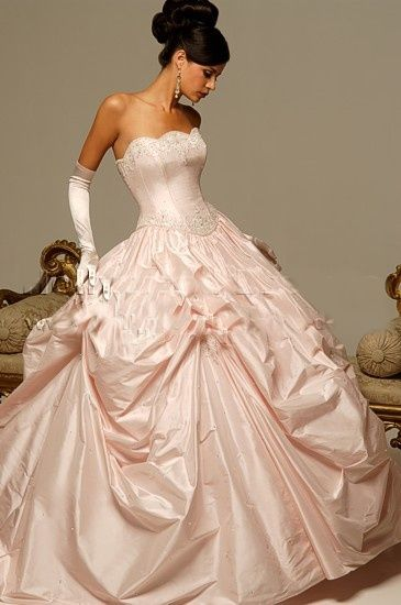 pale pink ruffled ballgown style strapless dress with embroidery along top and bottom of otherwise plain bodice. Also includes matching gloves.