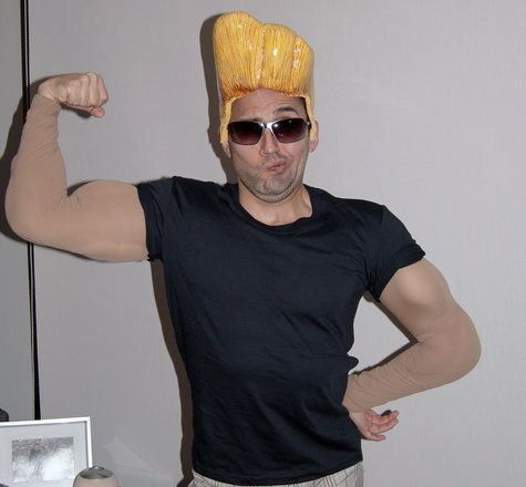Tom wants to be Johnny Bravo (he won't have to wear the fake muscles though hehe)  ; )   Johnny Bravo Costume
