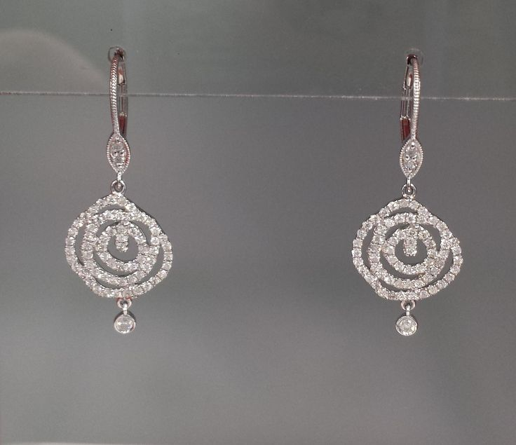 LOVE these 14k White gold and diamond forever roses...these won't wilt.  #diamondearrings