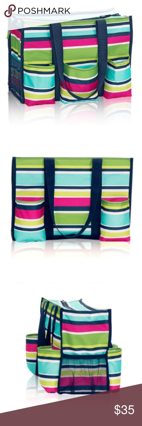 "🆕 Listing! Thirty-One Zip Top Organizing Tote Brand new, in original packaging Zip Top Organizing Utility Tote form Thirty-One. Preppy Pop color is full of bright colored stripes. Perfect bag for work, vacation, diaper bag and so much more! Dimensions: Approx. 10.75""H x 14.5""L x 6.5""D🚫TRADES Thirty-One Bags"