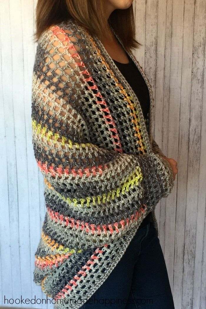 I really enjoy making cocoon sweaters. They're super easy to make and there are endless possibilities. Trust me when I say, any crocheter can make this sweater! If you can crochet a rectangle, you can make a cocoon sweater. I am obsessed with the yarn I used for this project. I used Yarn Bee's Urban Chic in Gray. I love everything about it… the colors, the feel, the weight… everything! The stitch I used is called the Open Filet Net Stitch. It's basically the granite stitch, but with double…