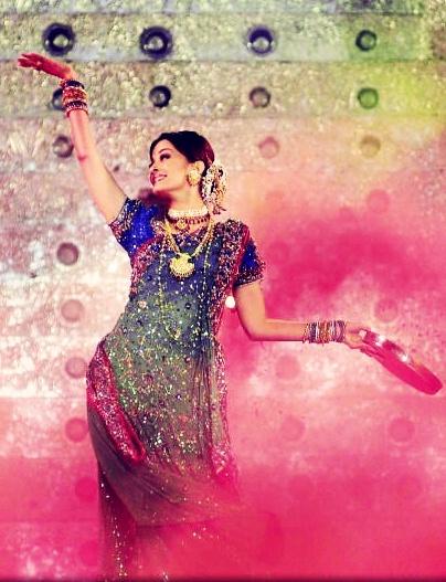 "Aishwarya Rai performing at an Award show, her dance track from  ""Devdas"" {2002}"