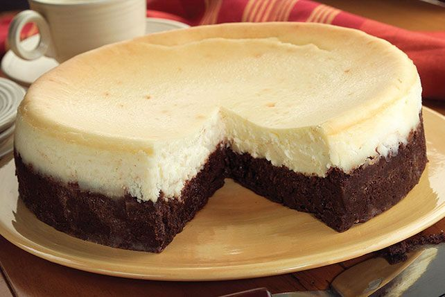 Treat everyone to a Brownie Bottom Cheesecake! Enjoy two desserts in one with this Brownie Bottom Cheesecake, perfect for your next party or get-together!