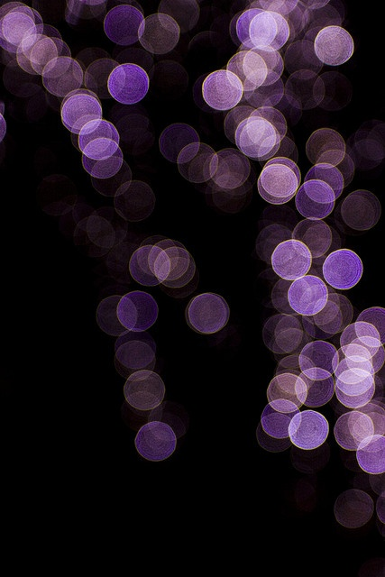 Purple Sparkling Dots on a Black Background