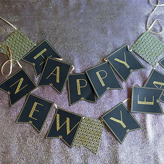 """Here is a printable """"Happy New Year"""" banner for your 1920's style party! This banner coordinates with the party hats and photo props."""