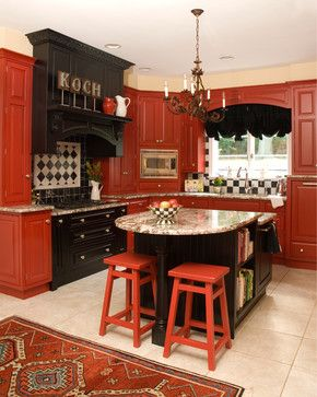 Decorating with Red ~ Painted kitchen cabinets paired with black looks sleek and polished.