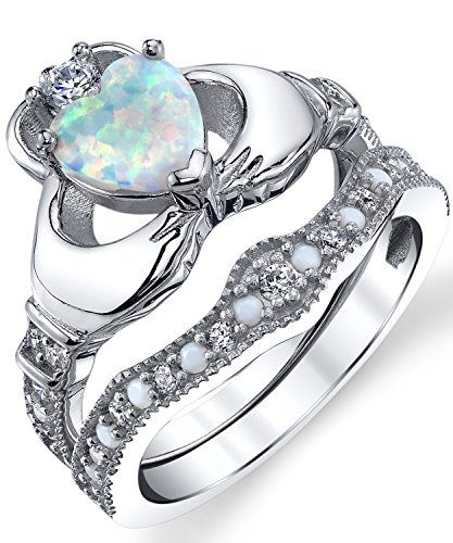 buy now   $179.99     (adsbygoogle = window.adsbygoogle || []).push();  Two hands clasp together to hold this beautiful heart shape simulated opal. A clear cubic zirconia is set on the crown to complete this Claddagh engagement ring set. Inspired by the traditional Irish symbol for...
