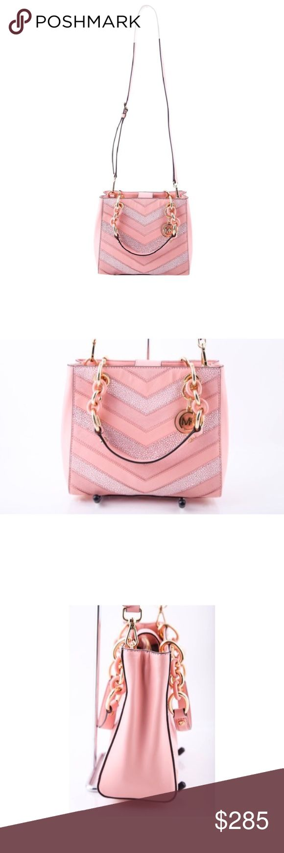 "Michael Kors • Blush Chevron Bag Fashionably updated in soft, chevron patch leather with a neat & tidy interior and matching links, MICHAEL Michael Kors' small Cynthia satchel offers an endlessly stylish look that will take you through the seasons. Double handles with 6-1/2"" drop; adjustable strap with 18""-20"" drop Magnetic snap closure Exterior features 18k gold-plated hardware Interior features center zip compartment, 1 zip pocket, 4 open pockets and key clip 9.75"" W x 8"" H x 3.25"" D New…"