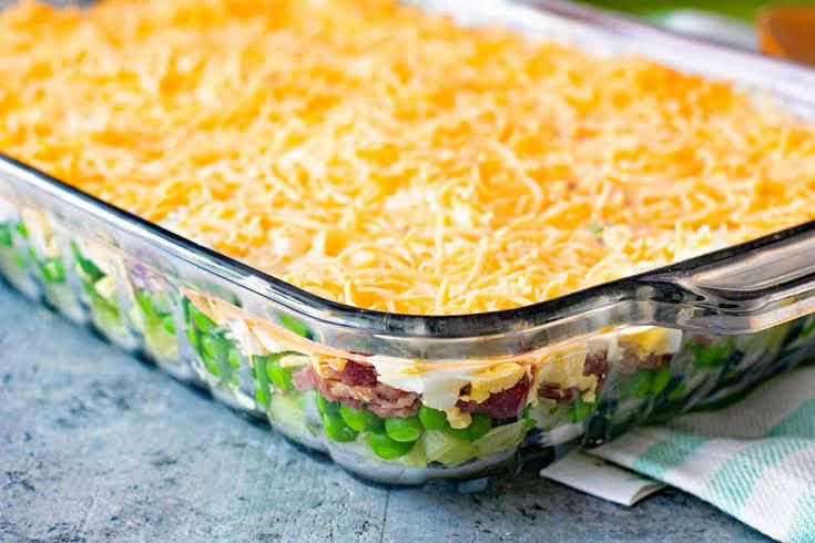 Traditional Seven Layer Salad With Iceberg Lettuce Frozen Peas Onion Celery Bacon Crumbles Hard Boil Layered Salad Layered Salad Recipes Seven Layer Salad