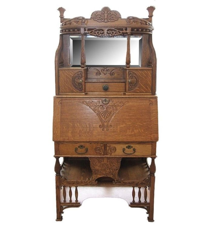 This lovely piece with carved and applied accents features mirrored back, two cabinets, brass handles, three small drawers, and shelving at the bottom. The front folds down to reveal a fitted interior with six pigeon holes and one small drawer.   eBay!