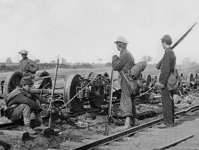 """""""Manassas Junction, Va. Soldiers beside damaged rolling stock of the Orange Alexandria Railroad."""" August 1862. 2nd Bull Run Campaign. Original from Library of Congress."""
