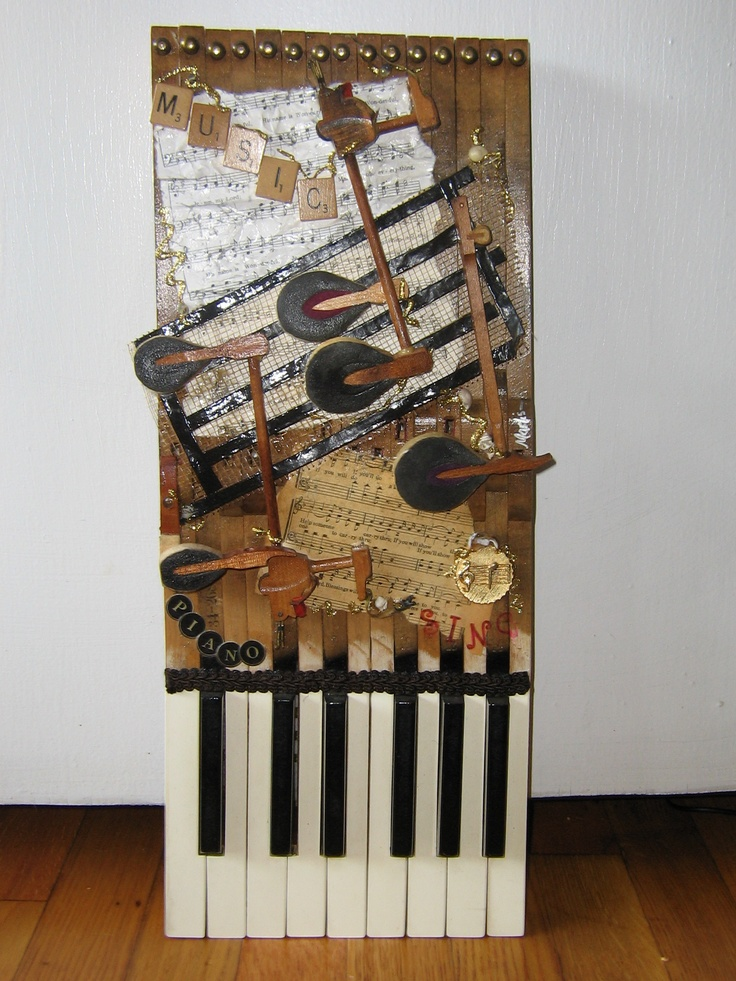 This is piano art made from discarded piano keys and hammers with varied embellishments.  If only these keys could talk!  $100