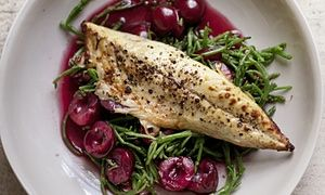 Grilled mackerel, pickled cherries and samphire on a round plate